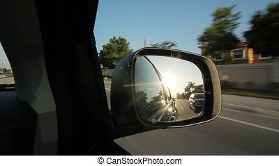 Suburban Florida. Sunny mirror. - Driving on a road past...