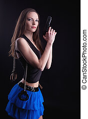 young girl with gun and handcuffs - young beauty girl with...