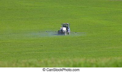 Farm tractor spraying field
