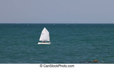Sailboat compeeting during regatta