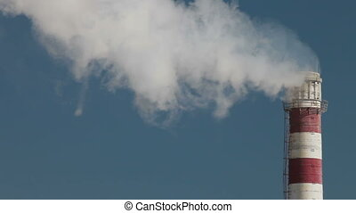 Smokestack Pollution - Industrial smokestack with billowing...