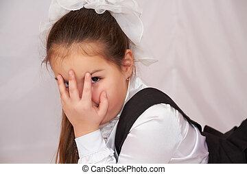 Little girl in school uniform.