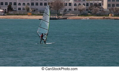 Speed Windsurfer - Young man windsurfing
