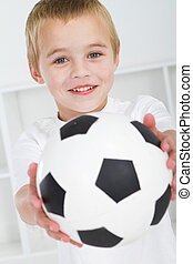 boy with soccer ball - happy boy with soccer ball