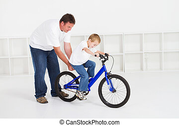 father teaching son ride a bicycle - father teaching son how...