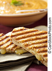 Soup and Sandwich - Grilled cheese sandwich with a bowl of...