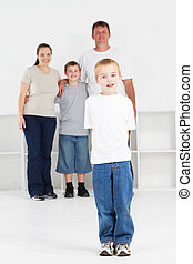 happy boy and family - happy boy standing in front of family