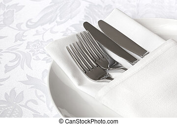 White Linen Place Setting - White linen napkin, with silver...