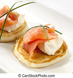 Smoked Salmon Blini - Blini topped with smoked salmon and...