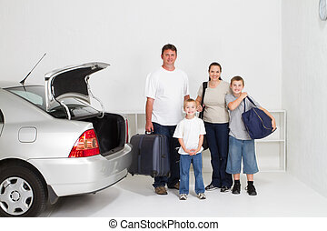 family road trip - happy family standing next to family car...