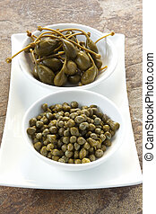 Capers and Caper Berries - Capers and caper berries, in...