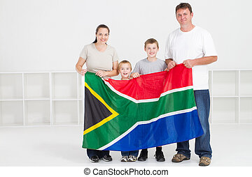 happy south african family with south africa flag