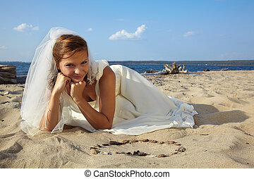 bride on sand - beautiful dreamy slavonic bride laying on...