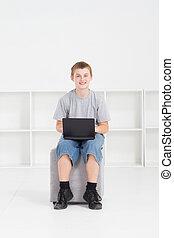 teen boy using laptop computer indoor