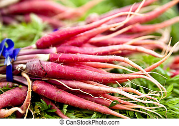Root vegetables - Purple vegetable roots at a local...