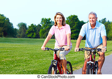 Seniors - Fitness and healthy lifestyle Senior couple riding...