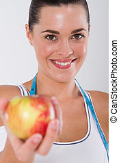 healthy fitness woman with an apple