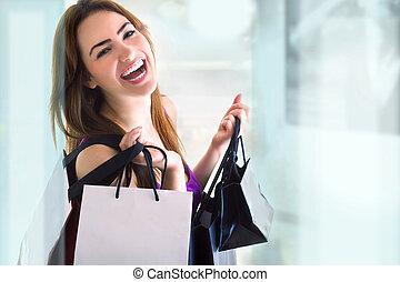 shopping - young woman doing shopping