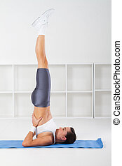 young fitness woman stretching