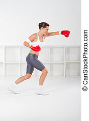 fitness woman with boxing gloves - young fitness woman with...