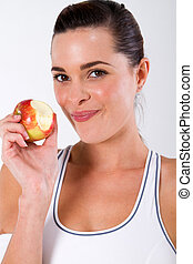 fitness woman eating apple - healthy fitness woman eating...