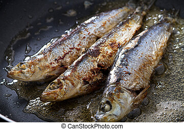 frying sardines in pan