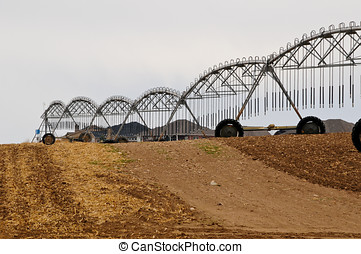 Pivot irrigation system ready to work - Plowed ground in the...