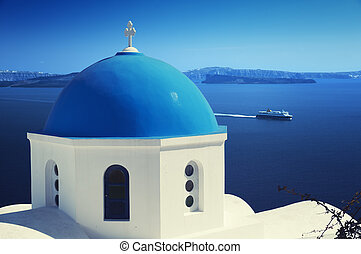 Santorini, Greece - Orthodox church and ferry at Oia Ia...