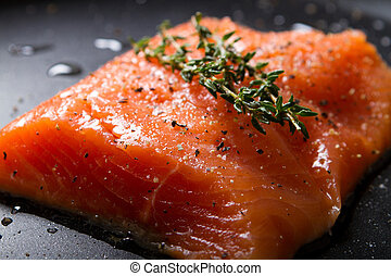 fresh trout fillet on a frying pan