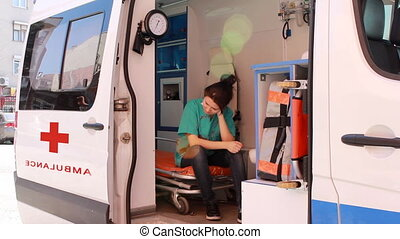 nurse thinking in ambulance