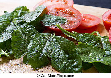 baby spinach and tomatoes