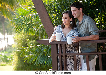 Couple On Vacation - A young couple on vacation standing on...