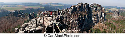 Panorama Saxon Switzerland - A group of tourists in the...