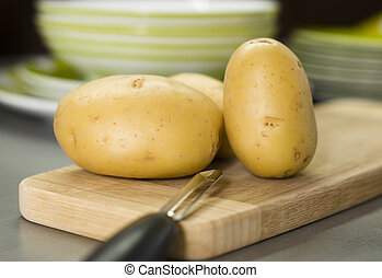 group of potatoes waiting on breadboard