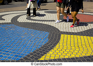 Las Ramblas, Barcelona - Colored pavement and people walking...