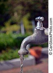 A running garden faucet tap