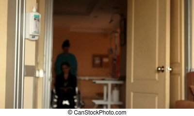 nurse carrying patient on a wheelchair