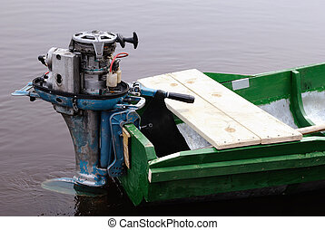 Outboard boat motor mounted on the transom
