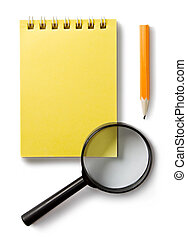 Notepad and magnifying glass isolated on white