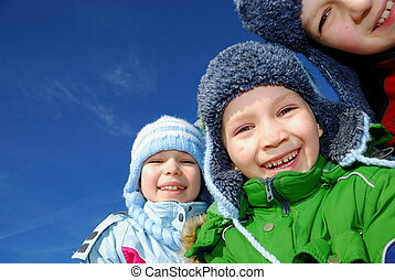 Happy children in winter - Two brothers and their sister...