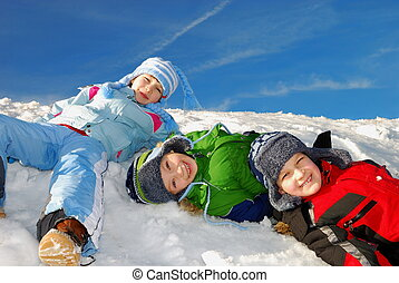 Children in snow - Three happy smiling caucasian white kids...