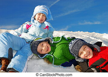 Children having fun in snow - Three happy smiling caucasian...