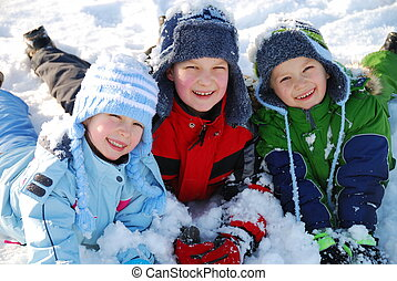 Children in snow - Three happy smiling caucasian kids in...