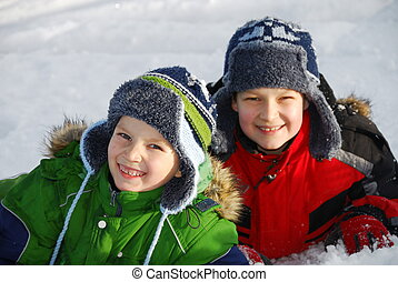 Brothers playing in snow