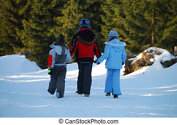 Walking Children in Winter - Three children holding hands...