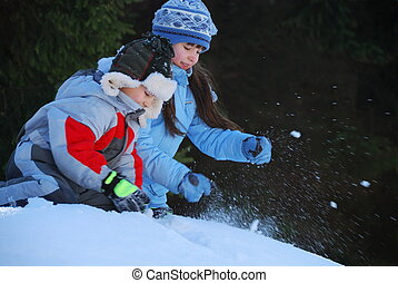 Snowball Fight - Cute children wearing warm clothes, having...