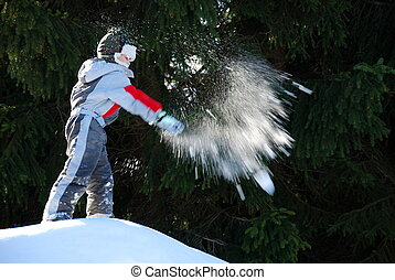 Boy Throwing a Snowball - A young boy throwing a snowball...