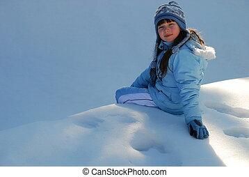 Girl sitting in snow