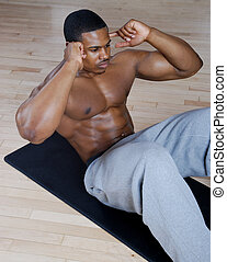 African american doing sit ups and crunches - This is an...