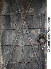 Old door - Very old rusty metallic door.